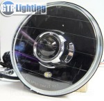 "This 7"" round dual beam projector headlight is available in black or chrome."