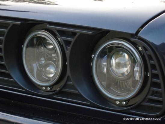 JW Speaker 6130 LED headlights custom-installed on a BMW car.