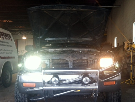 The headlight on the right is the original halogen sealed beam headlight. The white light on the left is the new housings with the new LED headlight bulbs.
