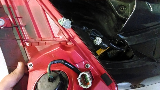 Here you can see the wire harness on the back side of the new tail light matches up perfectly to the disconnected 2005 wire harness. Make sure if you are getting a set of new style tail lights for your car that it comes with this little harness!