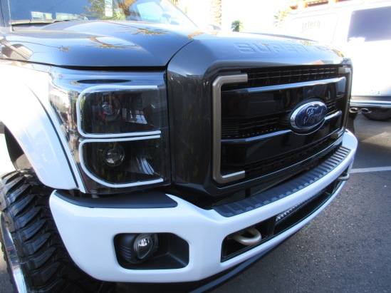 White silicone or rubber strips used for custom headlight accents.