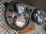 Here you can see a set of JW Speaker 8700 LED headlights, branded with the Jeep logo hanging up in the Jeep display booth at SEMA 2014.