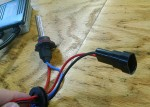 You want to find a section of the power input harness with the 2 smaller wires exposed so they can better wrap around and through the ferrite coil to form a loop.