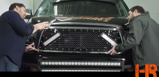 Re-attach the grille to the truck.
