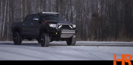 2010 Toyota Tundra featuring a Royalty Core steel-mesh grille with a pair of Vision X LED offroad light bars installed.